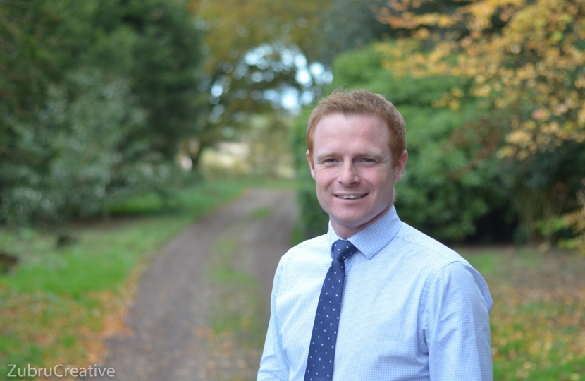 Photograph of newly selected Parliamentary Candidate for Keighley, Robbie Moore (standing in front of an avenue of trees